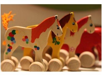 Mažas arkliukas su ratukais oranžinis 8